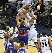 Vince Carter of the Grizzlies blocks the shot  of Mindaugas Kuzmihskas of the Knicks. (Photo: Warren Roseborough)