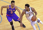 Wayne Selden drives with the Knicks' Courtney Lee applying defensive pressure. (Photo: Warren Roseborough)