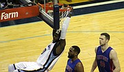 JaMychal Green broke free for a fast break dunk during the Grizzlies' 90-103 loss to the Detroit Pistons on April 9.