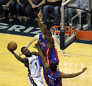 Tony Allen takes it to the hole and draws contact during the Grizzlies' 90-103 loss to the Detroit Pistons on April 9.