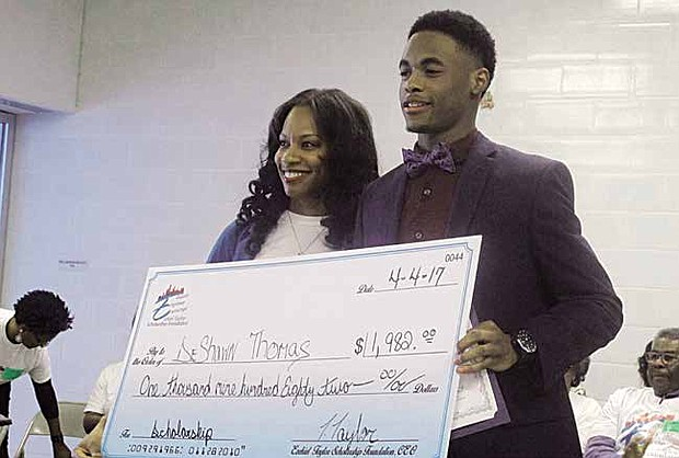 Chicago native and former Quentis Bernard Garth (QBG) Foundation Scholarship recipient, Tenisha Taylor Bell awards South Shore International College Preparatory Academy senior and student-athlete DeShawn Thomas with The Ezekiel Taylor Scholarship of $1,982, which represents the year Bell's father died on the Southside of Chicago.
