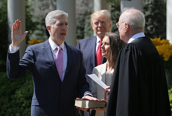 President Donald Trump praised new Supreme Court Justice Neil Gorsuch during a White House swearing-in ceremony on Monday as a ...