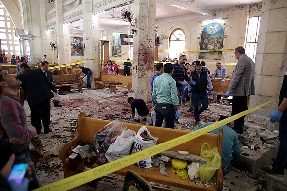 Egyptian Christians were burying their dead Monday after Islamic State suicide bombers killed at least 45 people in attacks on ...