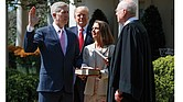 Justice Neil Gorsuch is sworn into the U.S. Supreme Court Monday by Justice Anthony Kennedy during a public ceremony in the White House Rose Garden. Justice Gorsuch's wife, Marie Louise, holds the Bible, while President Trump observes.