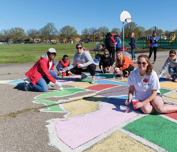 Cityscape // A team of volunteers paints a map of U.S. states on the Woodville Elementary School playground Saturday. From left, they are Katrina Washington, Michael Hill, Katie Gallagher, Tara Wagstaff, Olivia Jenkins, Laura D'Antonio and Victoria Hauser. Right, Richmond Schools Superintendent Dana T. Bedden  joins Michael Hill, a fourth-grader at William Fox Elementary School, in painting Florida. 