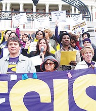 Members of several SEIU chapters rallied with Rep. Katherine Clark at the State House last week.