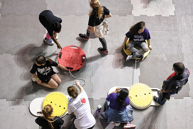 Richmond students use the basics of pulleys and gears to understand STEM in sports at Virginia Commonwealth University's Siegel Center