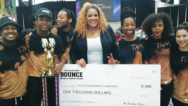 "Roxbury-based Trend En Motion, first prize winner of the Beantown Bounce, hold their $1,000 check along with special guest judge Andretta Garnes (center). The ""BOUNCE"" brought 1,500 fans to Reggie Lewis Track & Athletic Center in Roxbury on April 15, where they cheered on teams of talented dancers, singers and rappers. The annual Beantown Bounce was started by four female artists in 2005 to showcase youth talent and combat neighborhood violence."
