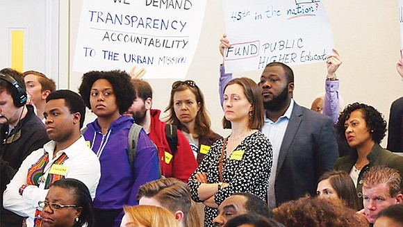 "Students, faculty and staff from UMass Boston interrupted a meeting of the UMass Board of Trustees chanting ""No cuts, no ..."