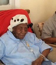 Violet-Mosse Brown, known as Aunt V, celebrates her 117th birthday with her son, 97.