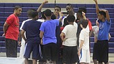 Tri-State Ballers Head Coach Danny Trezevant (facing camera with cap) gathers his players after a team practice.