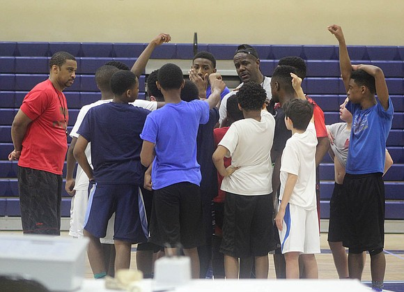 Tri-State Ballers AAU team using hoops to teach skills on and off court.