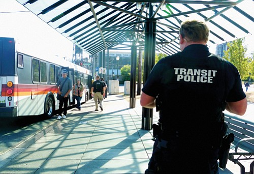 A TriMet photo shows transit police at the Rose Quarter.