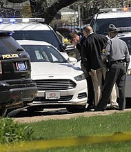Pennsylvania State Police look over a car as they investigate the scene where Steve Stephens, the suspect in the random killing of a Cleveland retiree posted on Facebook, was found shot dead Tuesday, April 18, 2017, in Erie. Pa. Acting on a tip, Pennsylvania State Police spotted Stephens, 37, in Erie County, in the state's northwest corner, and went after him. After a brief chase, he took his own life, authorities said. (Greg Wohlford/Erie Times-News via AP)