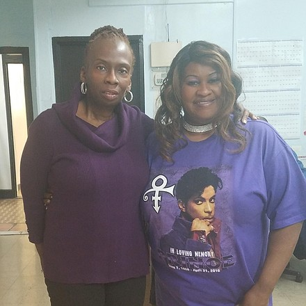 AmNews staffers Antoinette Donegan and Barbara Williams wearing their purple in honor of Prince