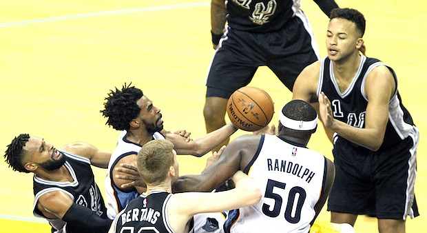 As Mike Conley makes his scoring move, Zach Randolph clears a path. (Photo: Warren Roseborough)