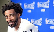 Mike Conley's winning smile after the Grizzlies beat the Spurs 105-94 at the FedExForum. G4 on Saturday, back at the FedExForum. (Photo: Karanja A. Ajanaku)