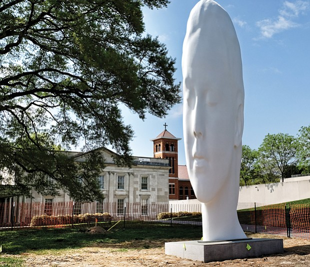 "Call it the new face of the Virginia Museum of Fine Arts. The dramatic 24-foot head now dominates the sculpture garden at the public art museum on the Boulevard. Titled ""Chloe,"" the sculpture is the creation of Spanish artist Jaume Plensa, who will be at the museum Thursday, April 27, for the dedication. The museum commissioned the contemplative work that is made of polyester resin and marble dust placed over a stainless-steel frame. ""Chloe"" is one of a series of heads that Mr. Plensa has created for museums in the United States and overseas, and defines the VMFA's ambitions to commission national and international artists to provide new works for the nearly 4-acre E. Claiborne and Lora Robins Sculpture Garden."