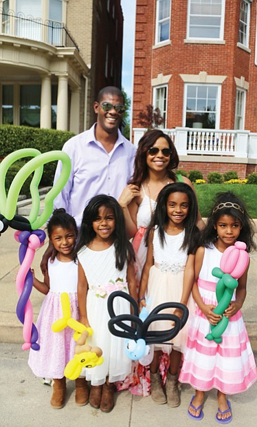 See and be seen  at Easter on Parade // Tillman and Cassie Breckenridge of Midlothian enjoy the day with their four daughters, from left, Paige, 4, Brynn, 5, Reese, 8, and Avery, 5.