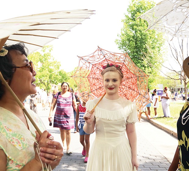 See and be seen  at Easter on Parade // three members of the Art Deco Society of Virginia, from left, Rita Shiang of Richmond, Anna Quilie of Carson and Christina Stewart-York of Chesterfield, draw admiring stares and some mutual admiration for their decorative parasols.