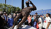 Fans, family and friends of baseball legend Jackie Robinson admire the statue of him stealing home base during last Saturday's unveiling outside Dodger Stadium in Los Angeles. This year marks the 70th anniversary of Robinson's historic breaking of the color barrier in Major League Baseball.
