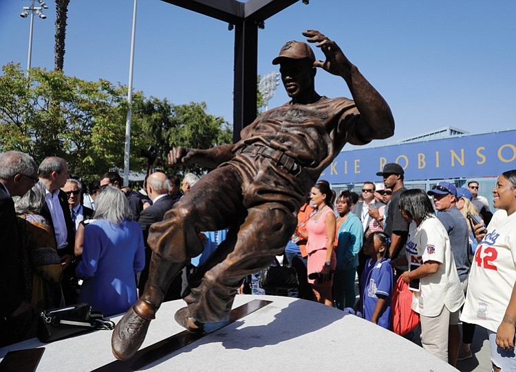 L.A. Dodgers unveil statue to celebrate Jackie Robinson Day ...