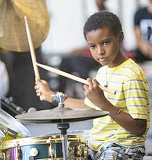 Kojo Roney, 13-year-old prodigy jazz drummer and the nephew of renowned saxophonist Wallace Roney will perform with his uncle at Caton Castle on Saturday, April 22, 6-10 p.m. Kojo Odu Roney has been playing since he was a toddler. Roney was able to play with jazz ensembles by age four and began his professional music career at age eight when he went on his first tour of Europe.