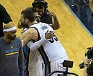 The victory secured, Mike Conley and Marc Gasol embrace before telling television audiences about the epic Game 4 win that knotted the series at 2-2. (Photo: Karanja A. Ajanaku)
