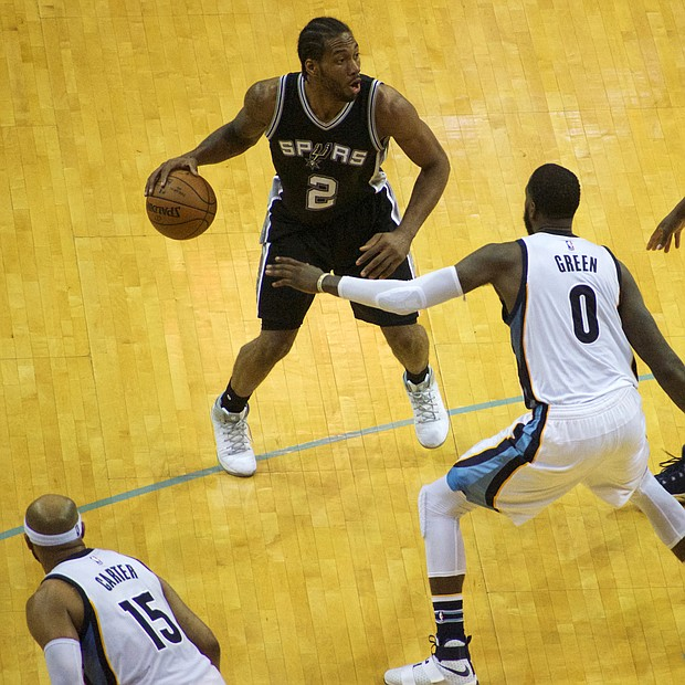San Antonio's Kawhi Leonard poured in 43 points, hitting big shot after big shot and drawing heavy attention from the Grizzlies. (Photo: Karanja A. Ajanaku)