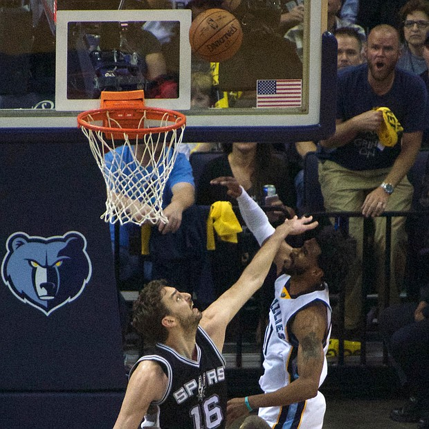 Mike Conley, who had a franchise postseason-record 35 points, charges the rim and San Antonio's Pau Gasol could not stop him. (Photo: Karanja A. Ajanaku)