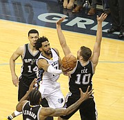 Mike Conley's force of will propelled the Grizzlies throughout the overtime thriller. (Photo: Warren Roseborough)