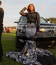Milan Bolden-Morris wore a dress featuring pictures of Trayvon Martin, Sandra Bland, Michael Brown, and others to her high school prom.