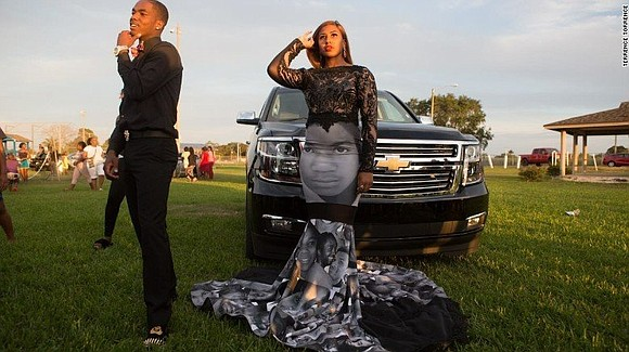 A Florida teenager wore a dress featuring pictures of Trayvon Martin, Sandra Bland, Michael Brown, and others to her high ...