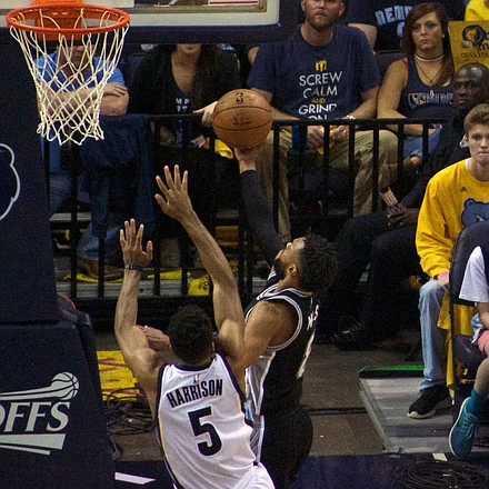 Andrew Harrison refused to give up when he saw the Spurs' Patty Mills on a breakaway and his block was a game saver. (Photo: Karanja A. Ajanaku)
