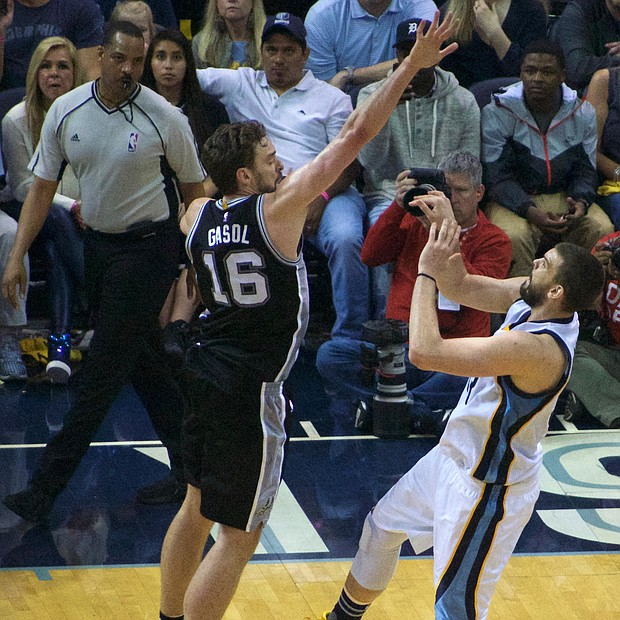 Too late brother: Memphis' Marc Gasol gets off and scores on a buzzer-beater at the end of the first half over his brother, Pau Gasol. (Photo: Karanja A. Ajanaku)