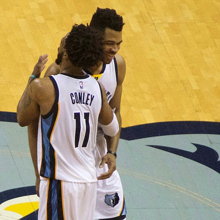 Way to go young fella: The Grizzlies star of the game Mike Conley shows Andrew Harrison how much he appreciated the rookie's hustle in tracking down and blocking the shot of the Spurs' Patty Mills with the game on the line. (Photo: Karanja A. Ajanaku)