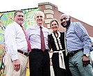 Challenge Discovery Projects staff members hope to serve more residents in their larger headquarters at the East End Family Resource Center on Jefferson Avenue. They are, from left, board President Dan Niccolucci; founder Daniel Stembridge; Denise Barnes, development director; and Curtis Lee Jr., community development coordinator.