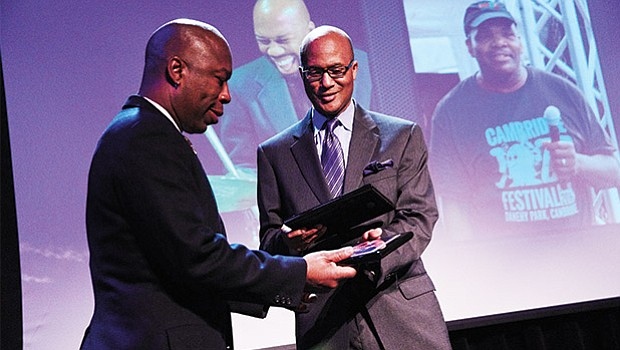 Berklee College of Music associate vice president Curtis Warner (right) presents the Berklee Urban Service Award to Professor Ron Savage for his work in establishing the Cambridge Jazz Festival and the Johnny Hodges Scholarship Fund.
