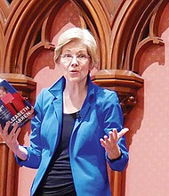 U.S. Sen. Elizabeth Warren shares a passage from her book during her appearance at the Old South Church.
