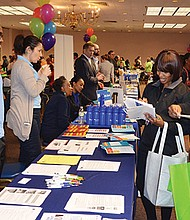 Prospective homebuyers talk to specialists during a recent event hosted by the Boston Home Center.