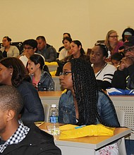 Participants engaged in a lecture about clinical sciences. (Photo Credit: John Coleman)