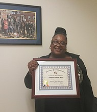 Debora Berry, an outreach minister who serves as a civilian chaplain for the Baltimore City Police Department, graduated from the chaplain academy of the Community Collaboration Division's faith-based program.