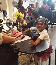 Makana Randolph getting her nails done at Cupcake City Socialite at the Queens Museum