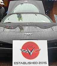 Corvette club enthusiasts showed they could handle the rain in style. (Photos: Karanja A. Ajanaku)