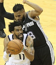 San Antonio's Patty Mills hounds the Grizzlies Mike Conley, who turned in another stellar performance in Game 6 of the NBA Playoffs. (Photo: Warren Roseborough)