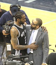 Spurs star Kawhi Leonard and Grizzlies Head Coach David Fizdale share a moment after San Antonio eliminated Memphis from the 2017 NBA Playoffs.