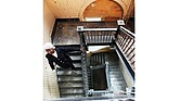 Margaret Stallings walks down the original wooden staircase inside the 114-year-old St. Luke building at 900 St. James St., which still has many of the coveted features of the city's older buildings.