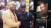 "Jason Johnson wasn't the only African American at the convention. Here he's joined by Colion Noir, a spokesmodel for NRA's ""CarryGuard,"" which provides legal support in case NRA members find themselves charged for killing in self-defense."