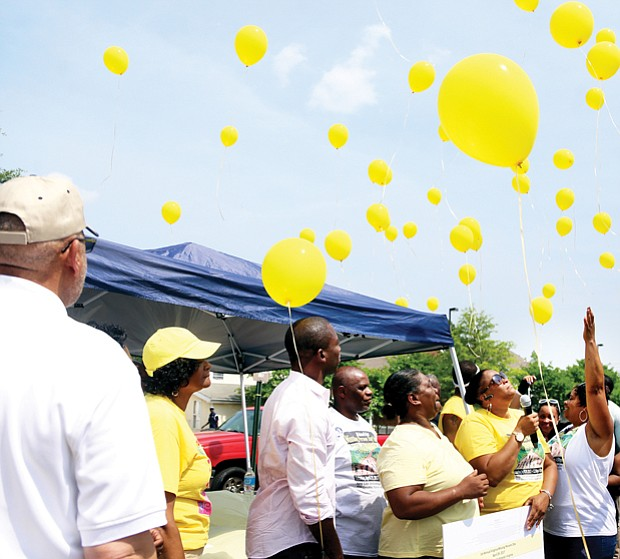 """For the missing // Yellow balloons are released to remember nearly three dozen people from the Richmond area who have been reported missing and whose whereabouts are unknown. The release came at the first """"Bring Our Missing Children Home"""" event hosted last Saturday by the mother of a 21-year-old who has disappeared without a trace. Location: New Life Deliverance Tabernacle in South Side."""