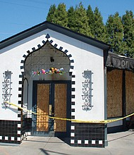 Reo's Ribs is boarded up Monday after an overnight fire gutted the landmark building housing the popular restaurant at Northeast 42nd and Sandy Boulevard.